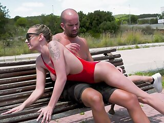 Dressed in a red-hot swimsuit, Lya Missy fucks on a public parkland tribunal